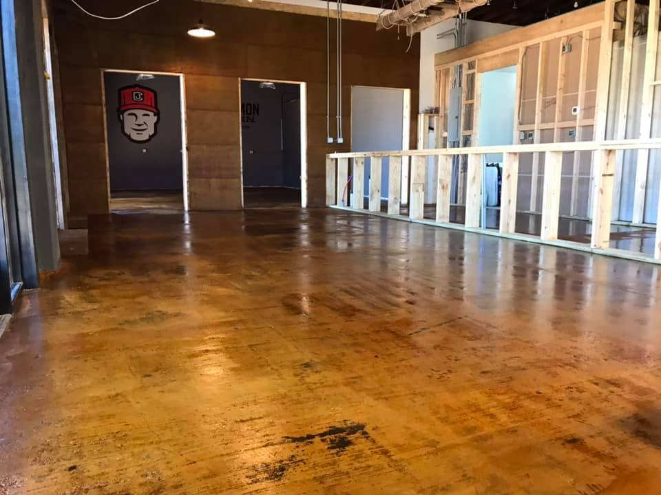The bar frame has been built and the taproom floor stain is down. Common John's inte…